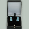 Earrings come in the presentation box illustrated