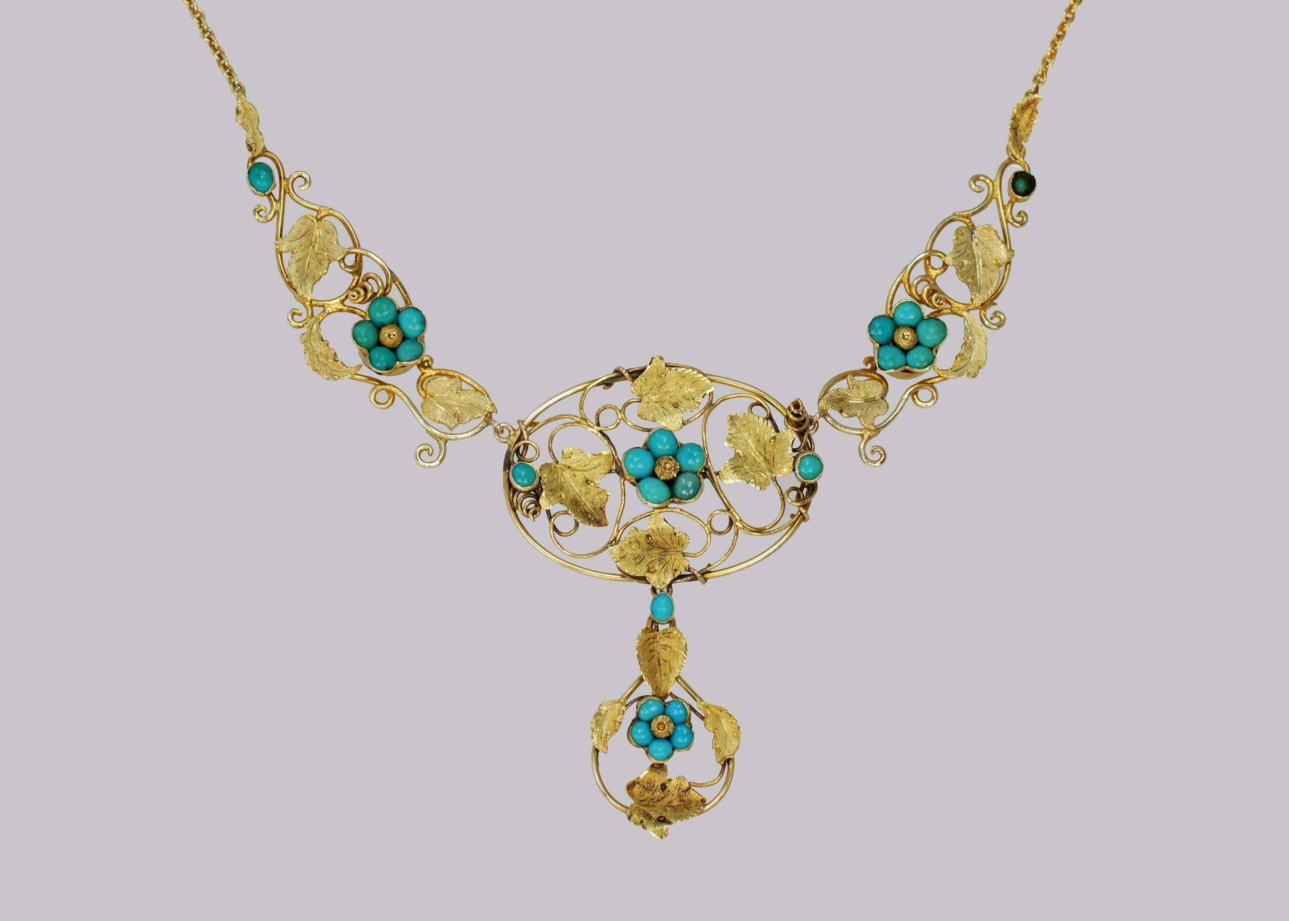 Turquoise necklace with naturalistic vine leaves