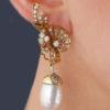 antique pearl drop earrings being worn