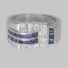 Ring with sapphires are pavé & claw set in white gold