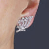 1920s Floral Scroll Clip On Antique Earrings being worn