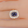antique sapphire cluster ring on finger